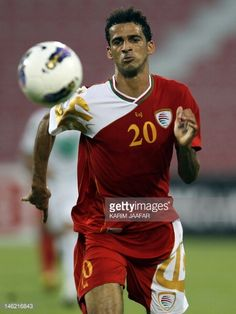 Oman's Imad alHosni eyes the ball during his team's 2014 World Cup Asian qualifying football match against Iraq in Doha on June 12 2012 The match...