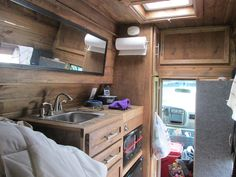 I bought a 2001 Chevy Express Van  with a high top roof for $2,800 in April 2015 and spent two months turning it into a manly-man cabin on w…