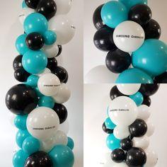 "Custom printed 17"" Balloons embellish this 2.2m organic column"