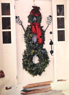 Adorable snowman decoration made of three door wreaths.