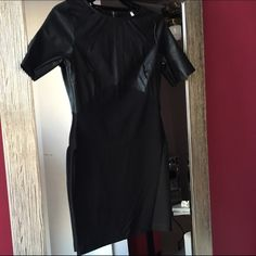"""Stretch Bottom Black Dress w/ Faux Leather Top ViJo Couture. Top of the dress is Faux Leather. Bottom is Stretch material. Exposed silver zipper in the back (see 2nd photo). Worn Once. Model is 5'3"""", 120 lbs with size A bra. ViJo Couture Dresses Mini"""