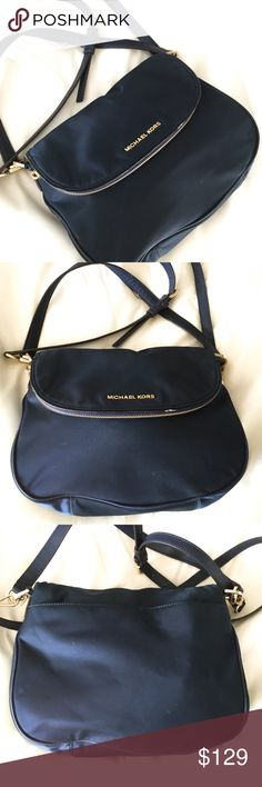 "AUTH MICHAEL KORS BEDFORD BAG An EUC authentic Michael Kors navy blue Bedford handbag. Approximate measurements are: 11 x 8 x 3"". Bag is in great used condition, there's a slight imperfection in the front by the zipper. To clean, simply wipe w a wet cloth. Adjustable shoulder strap. Silver hardware. Zip pockets and slip pockets. My hologram lining.  POSH RULES ONLY NO PP NO LOWBALL OFFERS  HAPPY POSHING! Michael Kors Bags Shoulder Bags"
