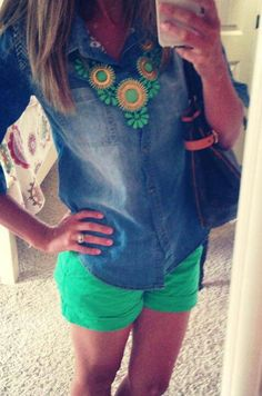 Chambray, jade green shorts, and statement necklace.