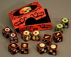 Printable - This strange little collection includes Full Moon Dice, Fang Dice,  Spider Dice, Eyeball Dice, and two different styles of Skull Dice.  There's even a storage box to keep your collection all together.  Happy Gaming from RavensBlight!