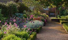 landscape design, gravel path, garden pathway, bordered beds, flowers, landscape architecture