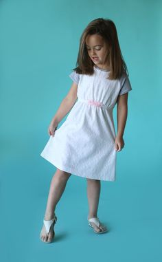 Adorable! Learn how to sew this cute raglan sleeve play dress for a little girl with the free printable PDF sewing pattern and easy tutorial.