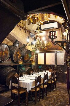 Los Caracoles  Carrer dels Escudellers 14 08002 Barcelona Spain   Classic place, opened in 1835, with old world ambience . Retains lots of historic charm. Classic dishes cooked on a wood burning fire, paella, grilled meats and fish prepared simply. Spacious rooms can accommodate larger groups.
