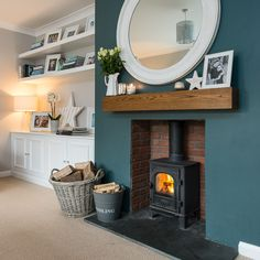 This cosy room has the chimney breast painted in Farrow and Ball Inchyra Blue Alcove Ideas Living Room, Feature Wall Living Room, Living Room Green, New Living Room, Cosy Living Rooms, Blue Feature Wall, Fireplace Feature Wall, Log Burner Living Room, Living Room Decor Fireplace