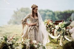 In her wedding to handsome pirate Will Turner, Keira Knightley's character Elizabeth Swann, wears a metallic and ivory, silk taffeta wedding gown with floral embellishment and lace trim. Unfortunately, the ceremony is cut short by an arrest warrant, but the 18th Century dress, designed by Penny Rose, still manages to steal the show