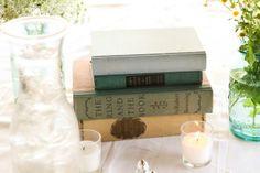 Vintage books as wedding table decor. Cate Jackson Photography www.catejacksonphoto.com