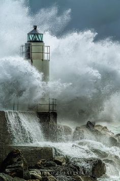 The sturdy Soldier of this Lighthouse standing silently as the bullying waves nearly engulf her.. ~*~moonmistgirl~*~