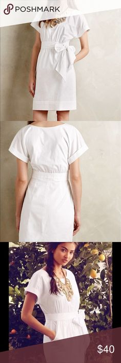 """Anthropologie white dress by HD in Paris Anthropologie white dress by HD in Paris. Built like in tie at the waist. Side zipper. Front pockets. Built-in lining. 5"""" slit in the back. Armpit to armpit this is 36"""", waist is 27"""", and from waist it is 21"""". 100% cotton. I think this felt morn suited for a size 2. Anthropologie Dresses"""