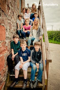 Ten cousins, captured on a family fun. Creating a fun moment makes them all relaxed. An example of family photography by Paul Saunders, available across Scotland, including Glasgow, Stirling and Loch Lomond.