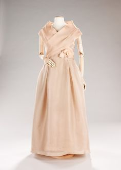 Evening dress Design House: House of Dior (French, founded 1947) Designer: Christian Dior (French, Granville 1905–1957 Montecatini) Date: spring/summer 1957 Culture: French Medium: silk Dimensions: Length at CB: 55 in. (139.7 cm)