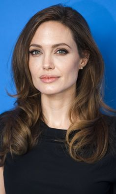 Bucking every hair colour trend that's hot on this season's catwalk, Angelina Jolie sticks to the classic ash chestnut shade that never faulters. Read more at http://www.instyle.co.uk/hairstyles/hair-trends/brown-hair/angelina-jolie#c6c6cY2oiFZgoULu.99