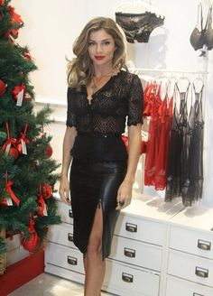 Black faux leather skirt with front zipper slit paired with see-through lace blouse.. DIY the look yourself: http://mjtrends.com/pins.php?name=plastic-zipper-for-skirt