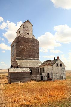 Alberta, Canada. Wow. You wouldn't want a lit cigarette within fifty feet of this old grain elevator. Dry grain dust is as explosive as TNT if a spark is lit. Wonderful old grain elevator though. Last of a dying breed.