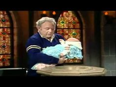 Archie Bunker Baptizes His Grandson (YouTube)