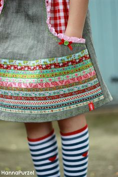 This is a creative idea. Sewn bands of ribbon to decorate a girl's skirt. Looks great.