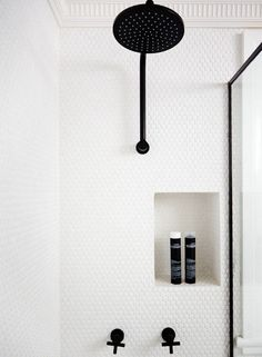 Penny-Round Tile The New Subway Tile White penny-round tile with white grout lets the matte black hardware stand out in this modern bathroom.White penny-round tile with white grout lets the matte black hardware stand out in this modern bathroom. Small Bathroom Interior, Bathroom Inspo, Bathroom Inspiration, Shower Bathroom, Bathroom Black, Bathroom Taps, Design Bathroom, Shower Tiles, Bathroom Ideas