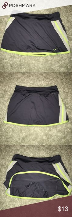 Nike tennis skirt Grey/purple skirt with bright yellow lining and shorts underneath Nike Skirts
