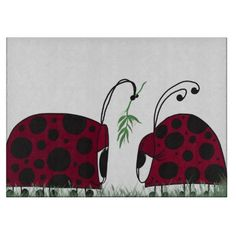 A Guaranteed Kiss Decorative Glass Cutting Board. Artwork designed by #OneArtsyMomma. $38.36
