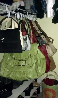 Organize purses by hanging with shower rings - Must do this in the extra room