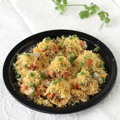 Sev Puri Chaat - Crispy papdis are topped with potato, mung beans, savory chutneys, onion, tomato and garnished with sev. This popular chaat snack is very easy to make and also you can prepare it in advance for birthday party, kids party etc. - Recipe with step by step photos
