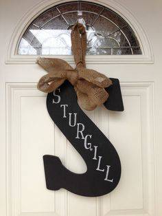 chalk board paint and burlap!! Would be easy to do with Rades. :)