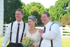 Country wedding attire: beautiful vintage dress for the bride and suspenders for the groomsmen