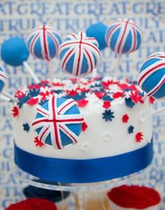 Generously sized cake pops help add even more delicious interest to this wonderful Jubilee celebration cake. Wedding Cake Maker, Wedding Cake Pops, Amazing Wedding Cakes, Amazing Cakes, Party Desserts, Just Desserts, Cute Cakes, Yummy Cakes, British Wedding Themes