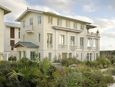 1930s Swedish Classicism with the charming vernacular of turn-of-the-century wooden American seaside resort houses