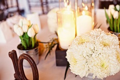 China mums, tulips, and candle centerpiece for chocolate, ivory, and green wedding.