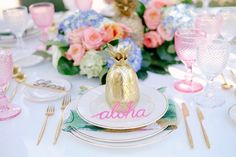 Tropical place setting in pink, blue and gold