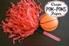 DIY crepe paper pom poms for cheering during game day!  So easy to make that the kids can do it themselves! #cbias #KettleMadness