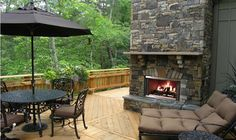 Accessories, : Killer Outdoor Living Space Decoration Using Dark Grey Outdoor Stone Fireplace Along With Round Black Iron Outdoor Coffee Table And Light Oak Wood Outdoor Flooring Outdoor Wood Burning Fireplace, Outdoor Stone Fireplaces, Deck Fireplace, Fireplace Design, Gas Fireplaces, Fireplace Stone, Fireplace Ideas, Deck Pictures, Outdoor Coffee Tables