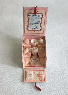 In my bubble: At your scissors  French tea set box with printables.  In French but site has translate button