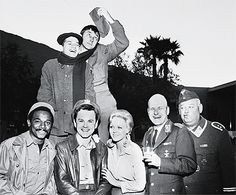 Hogan's Heroes cast.........this show is hilarious!! Back: Robert Clary (LeBeau), Richard Dawson (Newkirk). Front: Ivan Dixon (Kinch), Bob Crane (Colonel Hogan), Sigrid Valdis (Fraulein Hilda), Werner Klemperer (Colonel Klink), John Banner (Sergeant Schultz). Sadly, it's missing Larry Hovis (Carter), but that's ok.