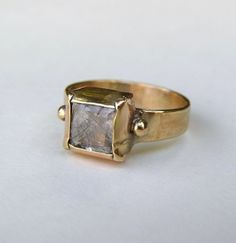 Pretty- i love how the bezel is folded over the stone- 14 kt yellow gold/quartz  orit naar design  kibbutz afikim. israel.
