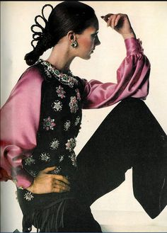 1968   Yves Saint Laurent's ravishing fringed black suede tunic with rosettes of pink and green stones, satin shirt and wide black velvet pants, photo by Penn,