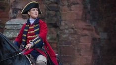 Starz's epic time-traveling historical fantasy series (say that five times fast), Outlander, has already achieved cult-like status in the short amount of time it's been on air. That is mostly thanks to the novels on which it is based — written by Diana Gabaldon — but it's also because of the stellar acting and storytelling happening on-screen. One such instance of that excellence is Tobias Menzies, who has the enviable (or un, depending on how you look at it) task of portraying two…