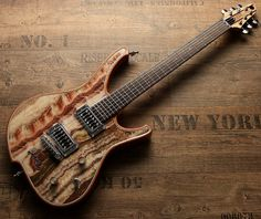 """Good news: My gorgonized Nemesis guitars now also can be pre-ordered at Red Dragon GuitarsToday I proudly offer you something very special.At the Anaheim NAMM show (January 2016) I debuted with my new gorgonized guitars with real stone top.  Those """"gorgonized"""" guitars have a chambered Mahogany body with a 5 mm top made of real stone like Amethyst, Tiger´s eye, Labradorite,Brazilian Onyx  Fantastico, White Italian Carrara marble and many more.The new guitars aroused a lot interest f..."""