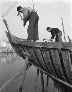 Chioggia Sails: Working On A Sail Two men working on a sail boat frame, Chioggia, Venice, 1950.
