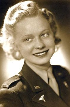 Evangeline R. Coeyman as an Army nurse during World War II. A corpsman who in civilian life was a Hollywood hairdresser fixed her hair for this photo, which she calls her 'glamour shot.' ~