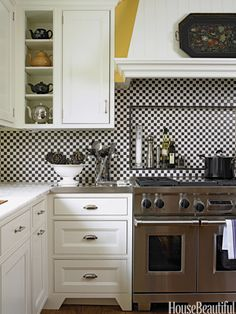 In this retro Chicago kitchen by designer Mick De Giulio, simple one-inch squares of black and white tiles make a graphic backsplash behind the Wolf range.