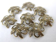 Antiqued Brass Filigree Nouveau Flower Bead by BumbershootSupplies, $3.50