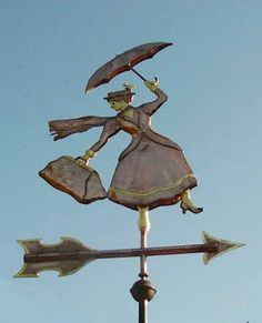 Very clever...she'll stay till the wind changes!  Although I'd put her in her classic floating pose.