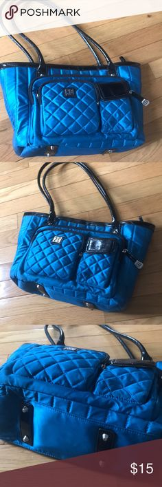 Cobalt Blue Purse Get seriously organized with this multi compartment, Giani Bernini shoulder bag! Stunning, cobalt blue exterior (feels like a plush, puffer coat!), black lining, and tan interior. Giani Bernini Bags Shoulder Bags