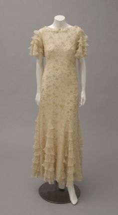 Woman's Graduation Dress and Slip Worn by Mrs. Harry Bronstein, née Hendella Klinghoffer. 1934 Ivory silk chiffon with all-over, machine-made ivory silk embroidery, ivory silk net; ivory silk satin Philadelphia Museum of Art