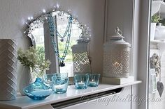 Aqua and white mantel decoration. This is an easy and pretty color combination for a mantel decor.